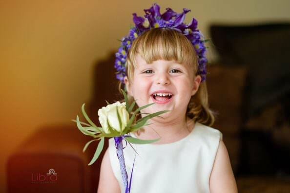 Flower girl holding White Rose Wand