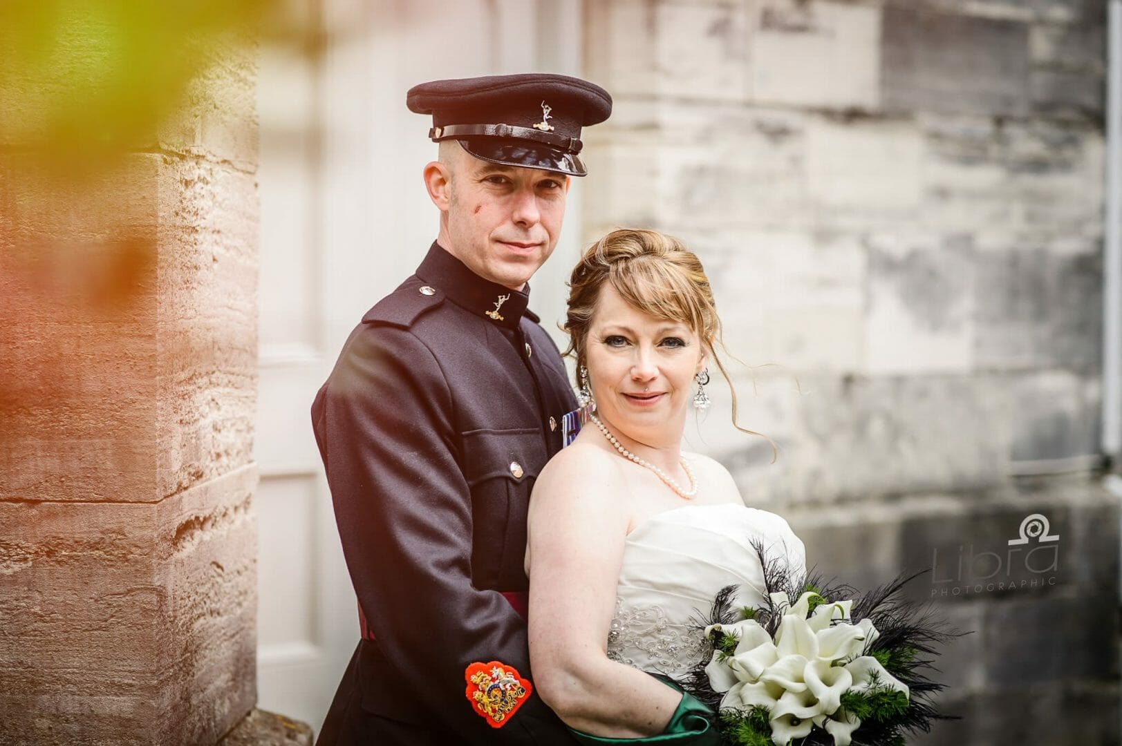 Couple pose at Poole quay church