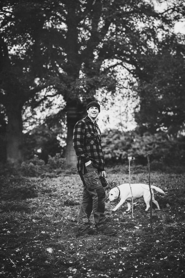 John poses with PTSD dog