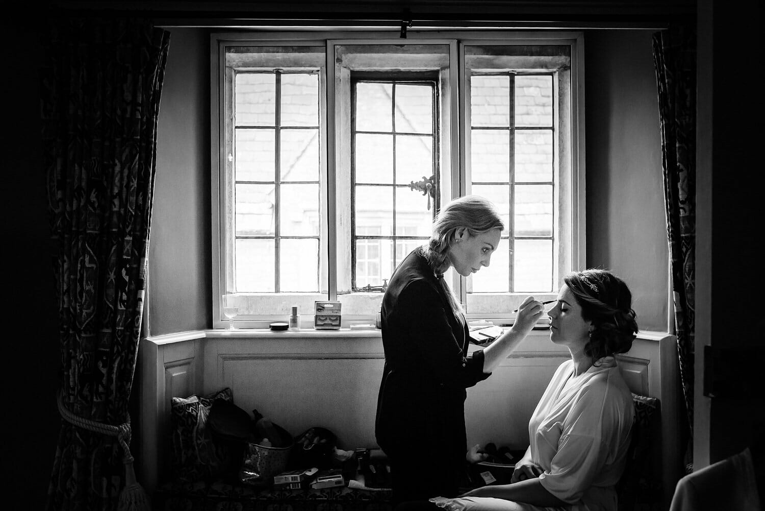 Bride and makeup artist in Window