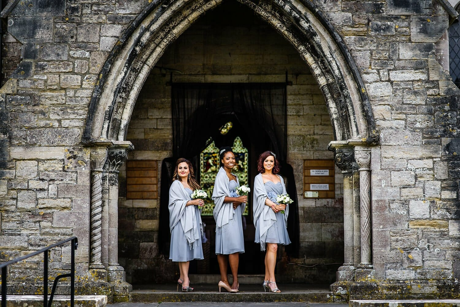 Bridesmaids wait for bride at St Edwards Church