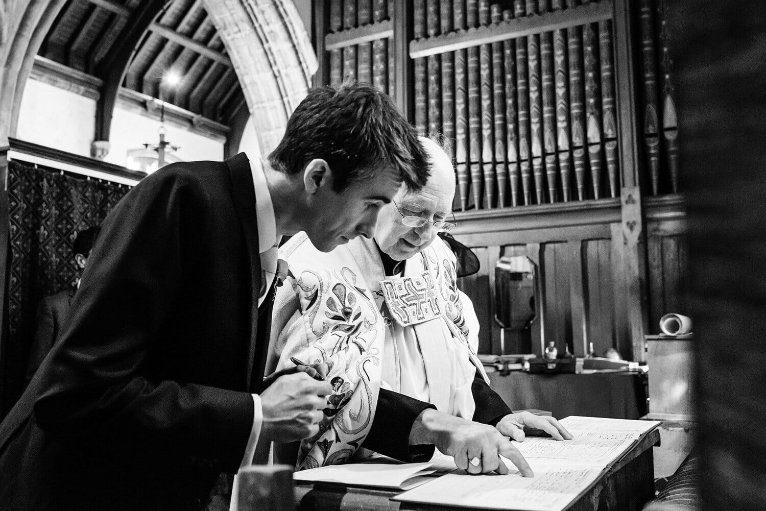 Signing the register with the Vicar