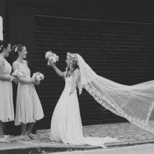 Black and white photograph on a wind blowing a veil in Poole Guildhall