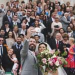 Bride and groom take selfie at Lulworth castle wedding