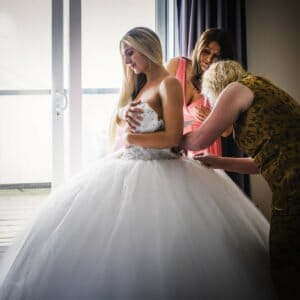 Bride putting on her wedding dress at the Sandbanks Hotel