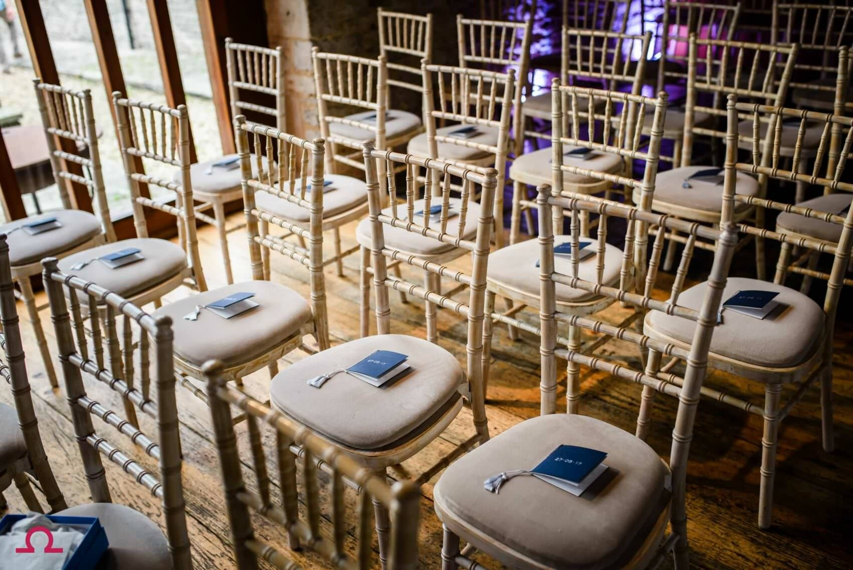 Orders of service on Chairs at Kingston Country Courtyard Wedding
