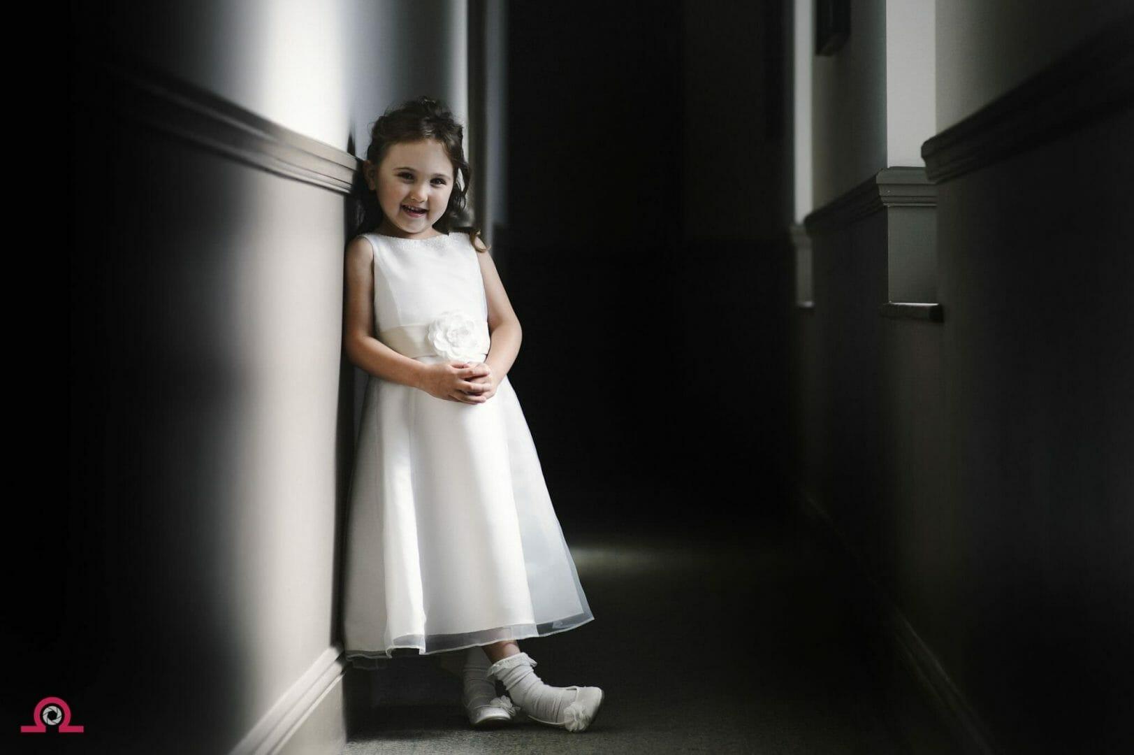 flowergirl waits by a hallway window in hotel Du Vin Poole
