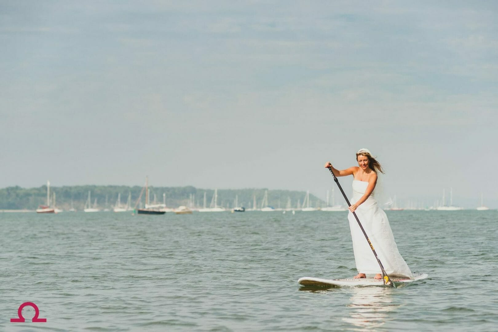 Bride paddle boards in Poole