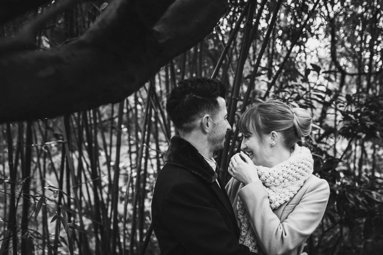 Groom makes bride laugh in the bamboo - Bournemouth gardens
