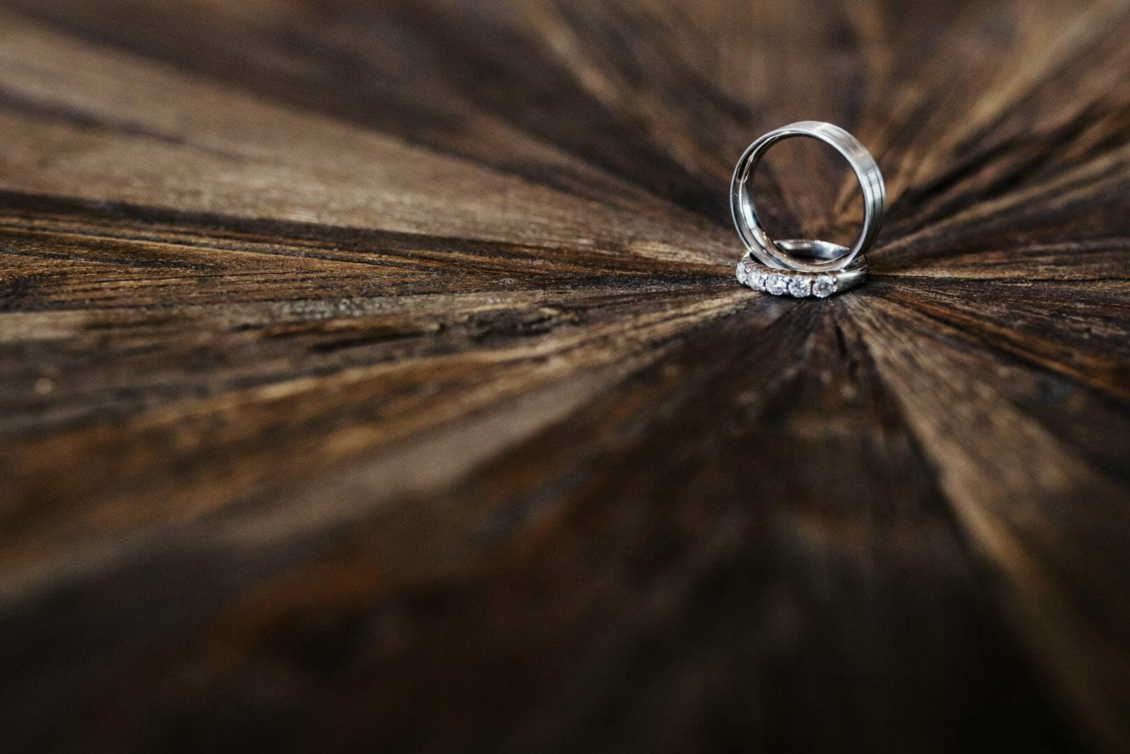 Wedding rings on wooden block