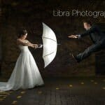 Groom flys away from brides umbrella