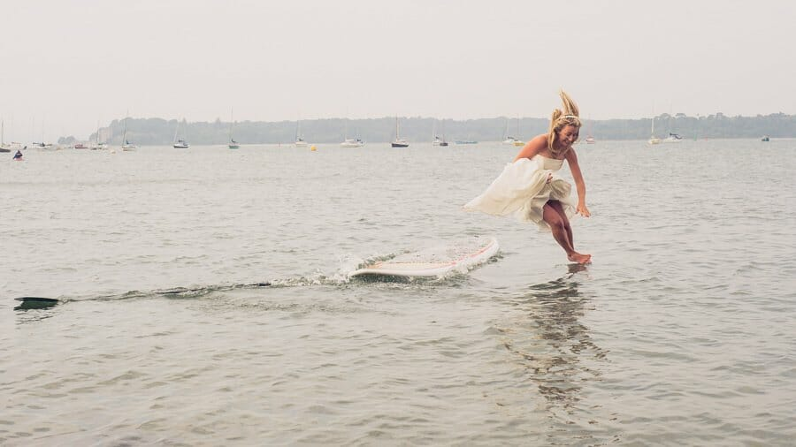 Bride jumping into water