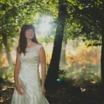 Bride posing in the forest