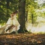 bride running through trees
