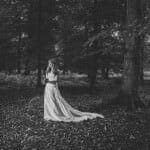 Bride posing in forest