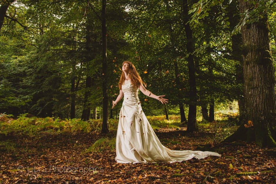 Bride throwing leaves in the air -New Forest wedding