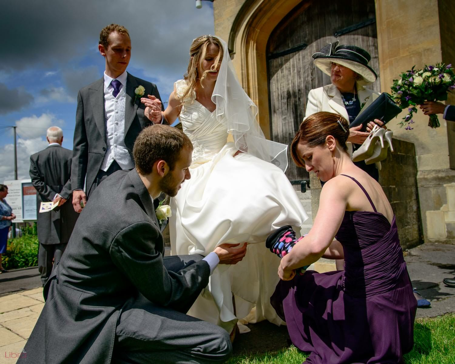 Bride changing shoes outside church