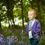 Little boy walking through Pamphill Bluebells