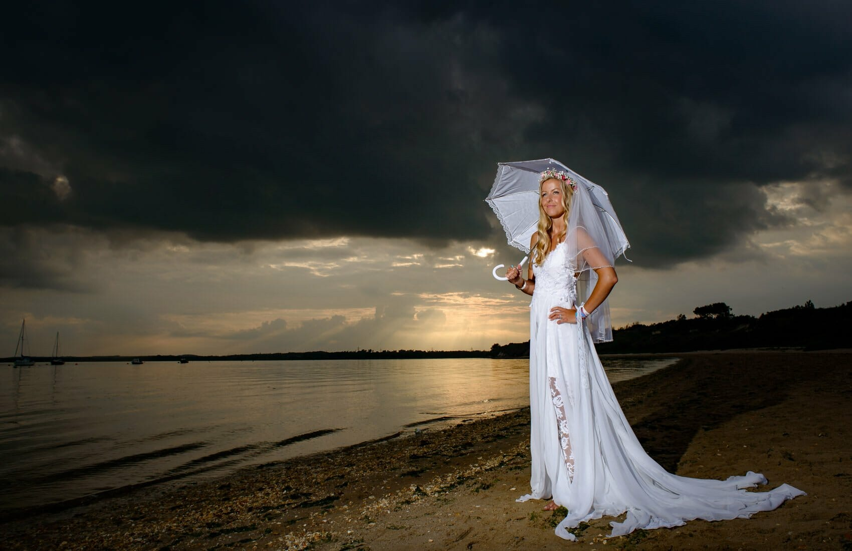 Stormy-beach-bride-with-parasol
