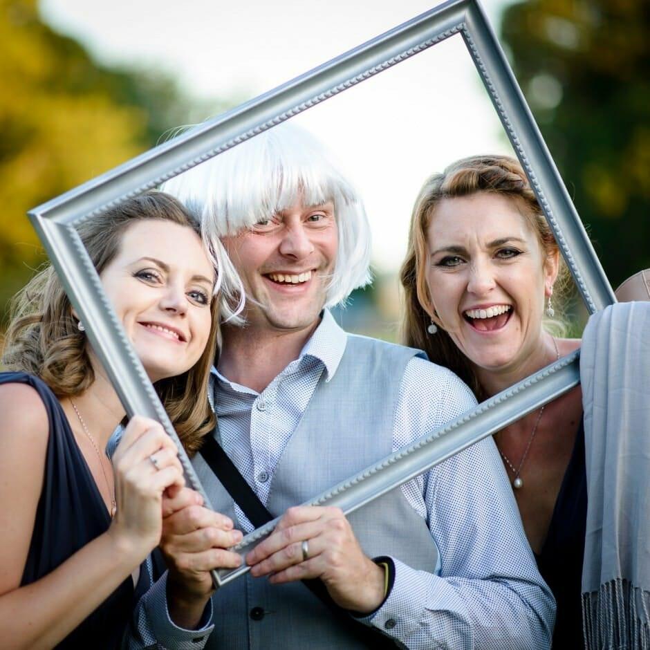 Hampshire Wedding Photographer having fun with bridemaids at Rhinefield House
